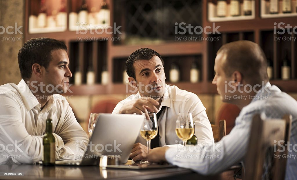 Businessmen in a bar after work. stock photo
