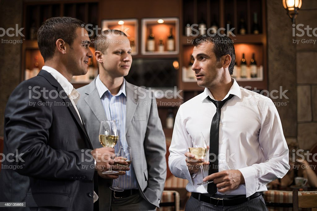 Businessmen in a bar. stock photo