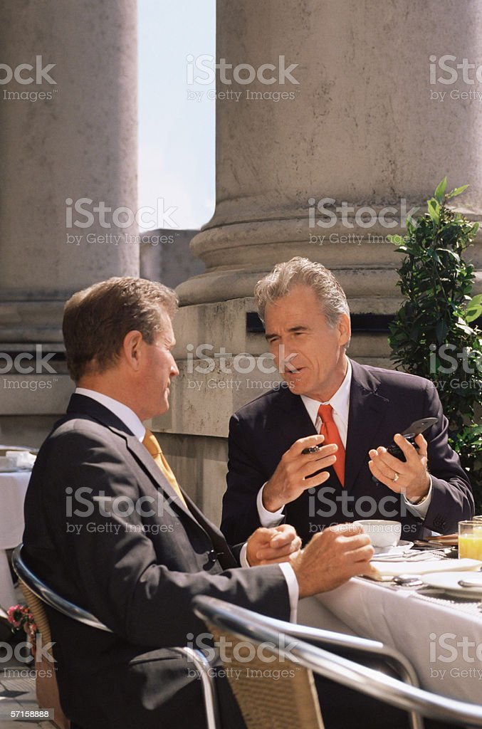 Businessmen in a restaurant stock photo
