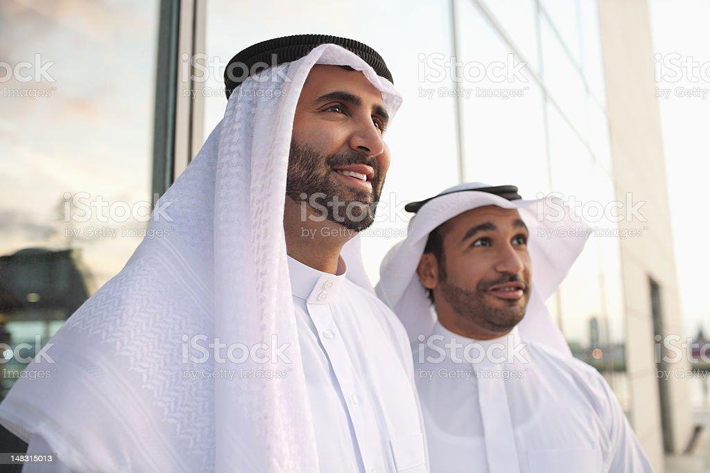 Businessmen in kaffiyehs royalty-free stock photo