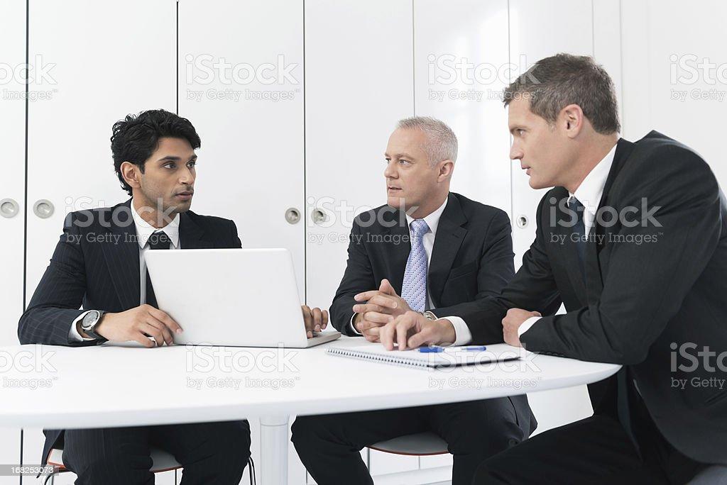 Businessmen In Meeting stock photo