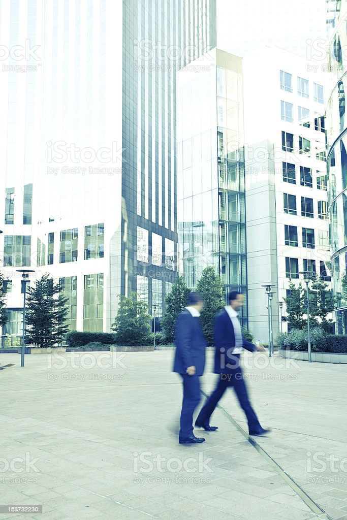 Businessmen in motion royalty-free stock photo