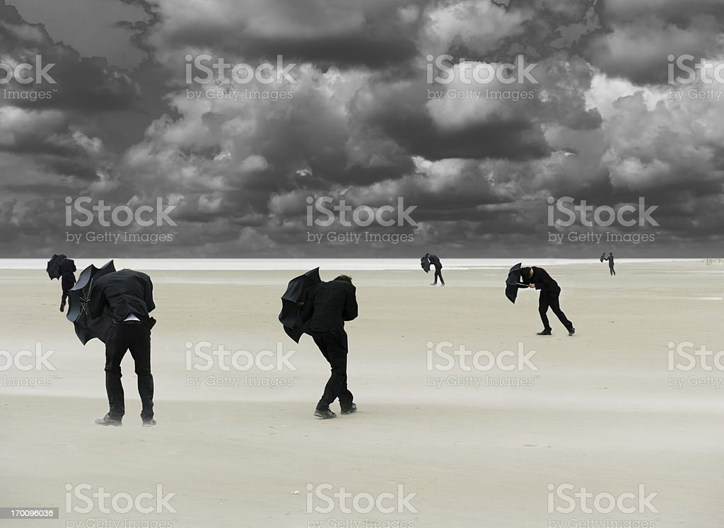 Businessmen in stormy weather royalty-free stock photo