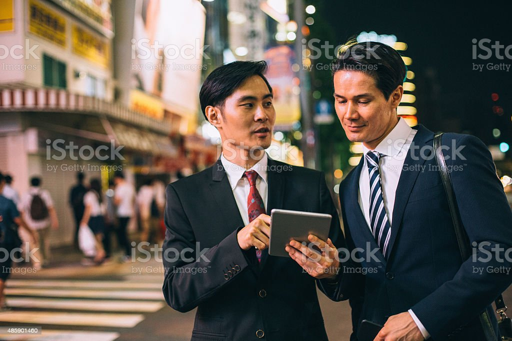 Businessmen in the city stock photo