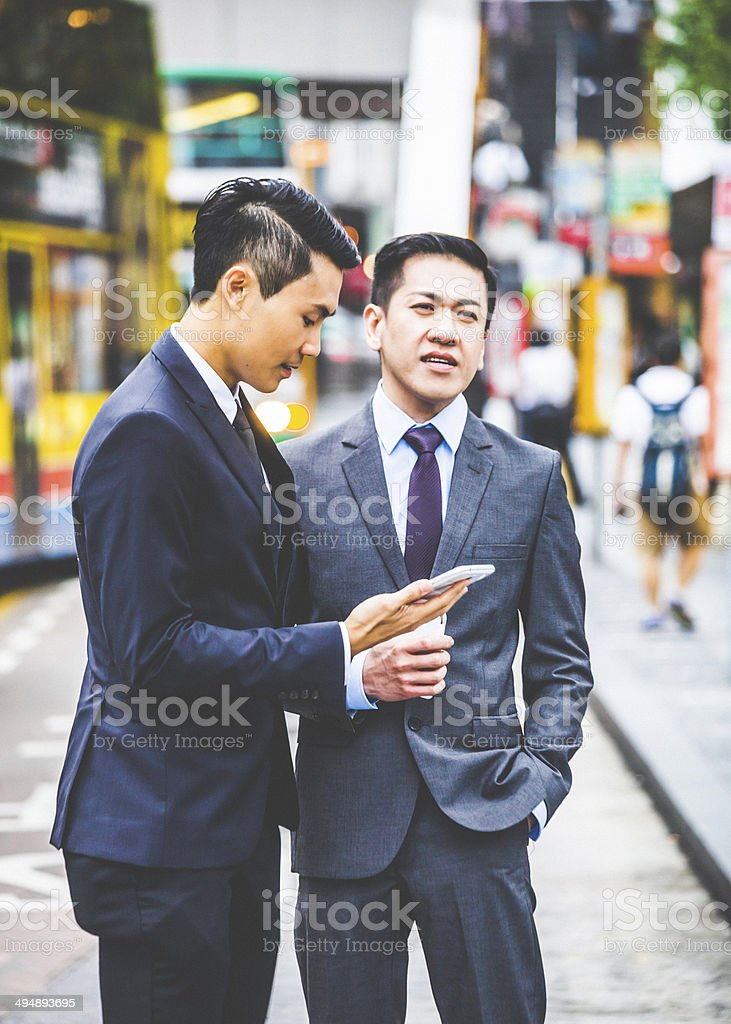 Businessmen in the street. stock photo