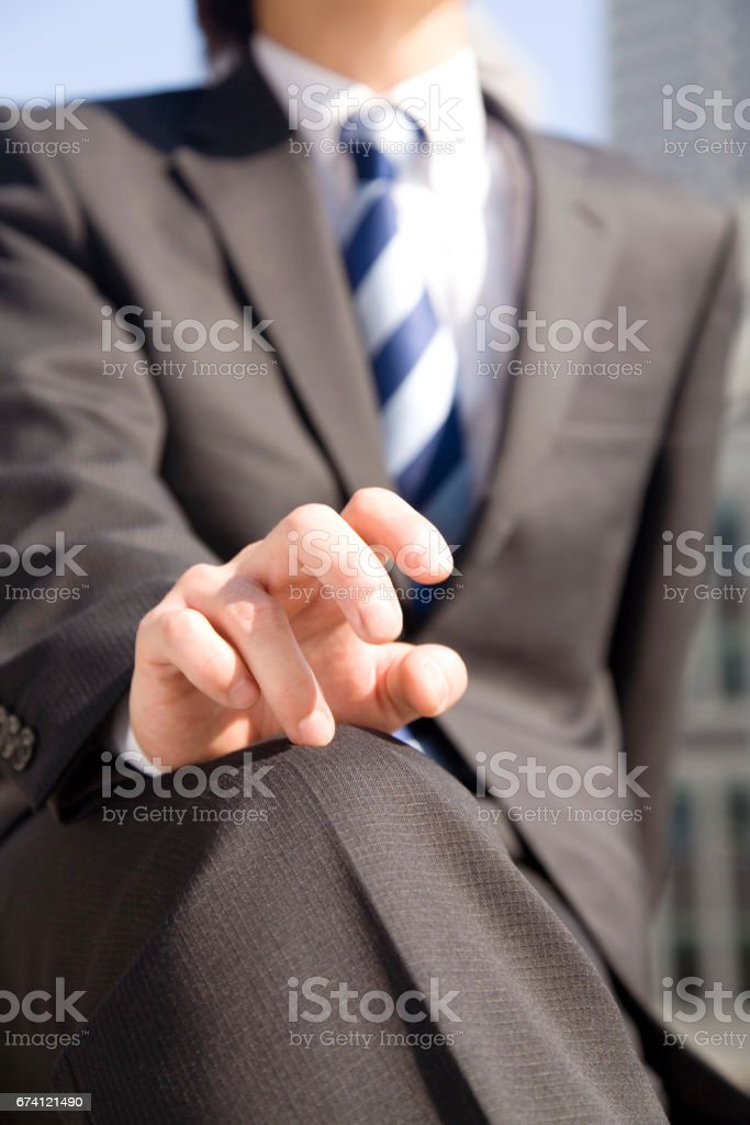 Businessmen keep hands on knees stock photo