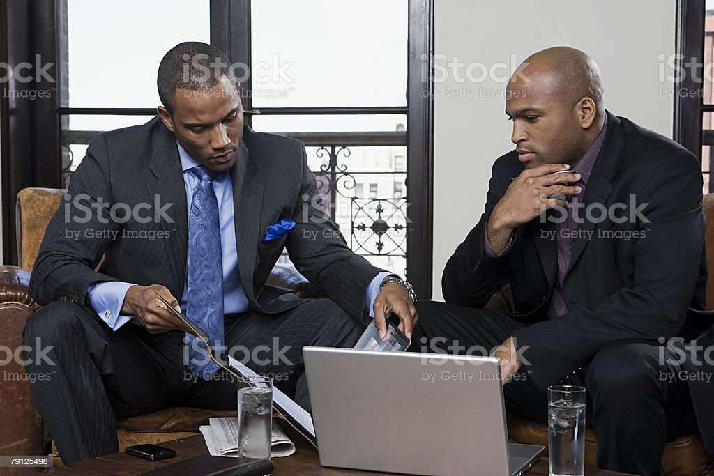 Businessmen looking at file royalty-free stock photo