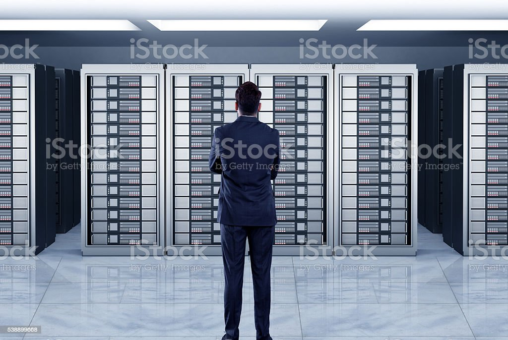 Businessmen looking at server stock photo