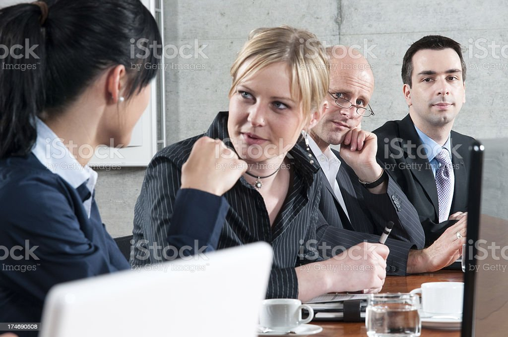 Businessmen looking into camera during a meeting break royalty-free stock photo