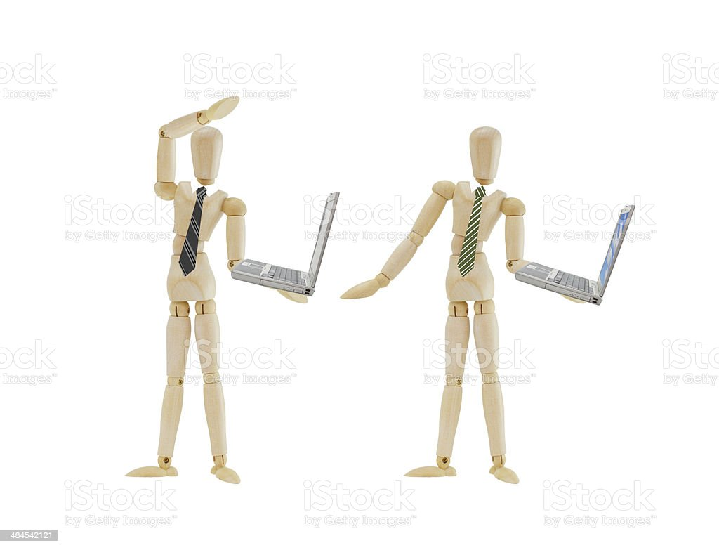 Businessmen Mannequins holding laptop computers stock photo