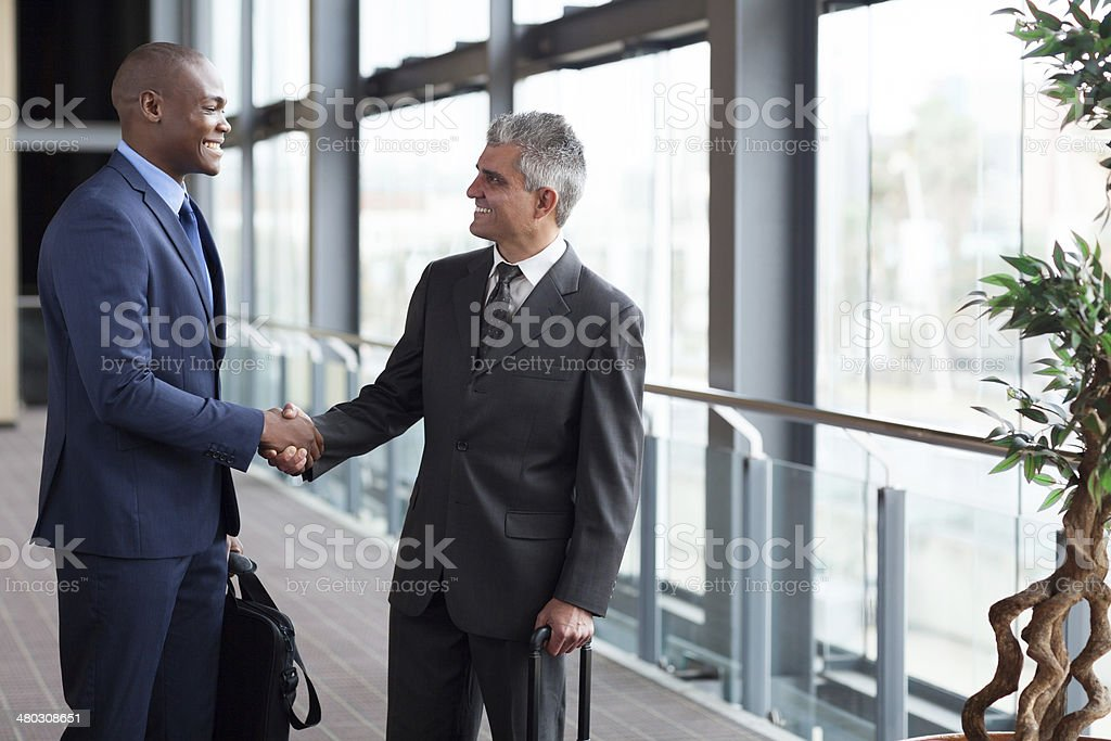 businessmen meeting at airport stock photo