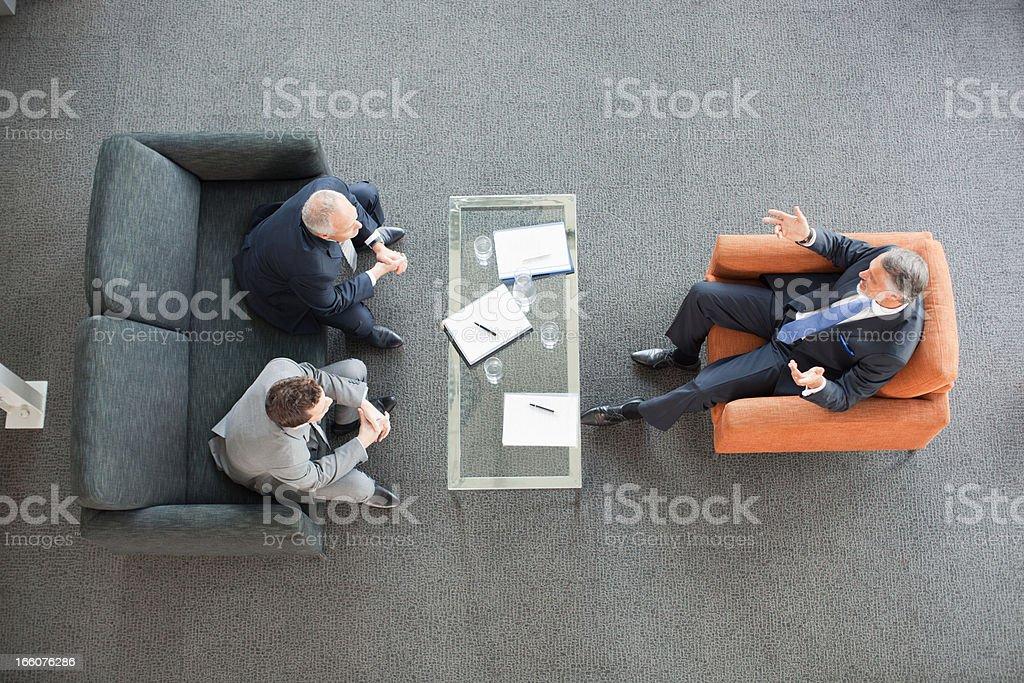 Businessmen meeting in lobby stock photo