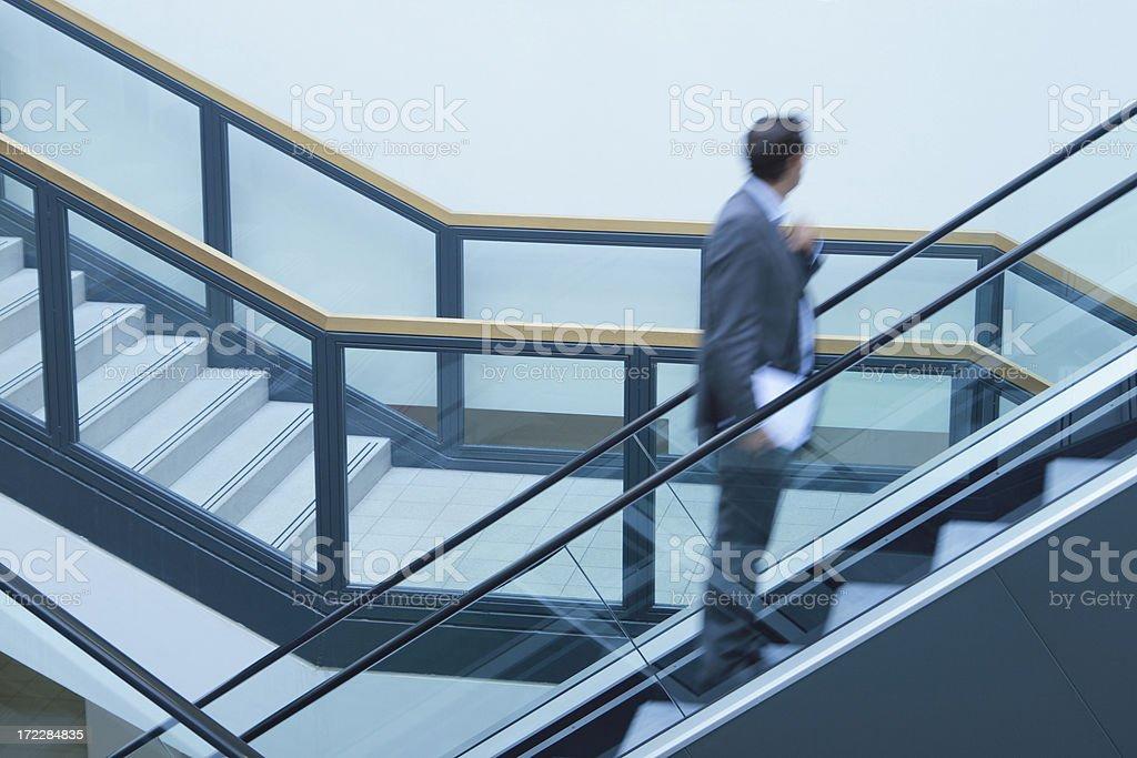 Businessmen on Escalator royalty-free stock photo