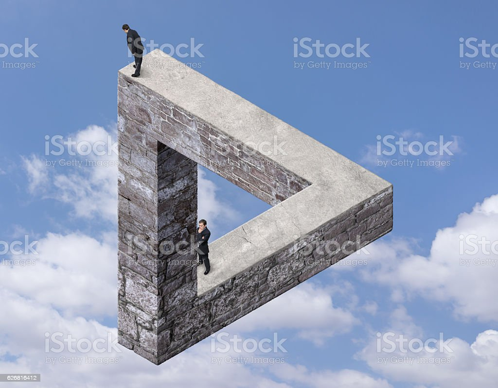 Businessmen on the Impossible Triangle Made with Stone stock photo