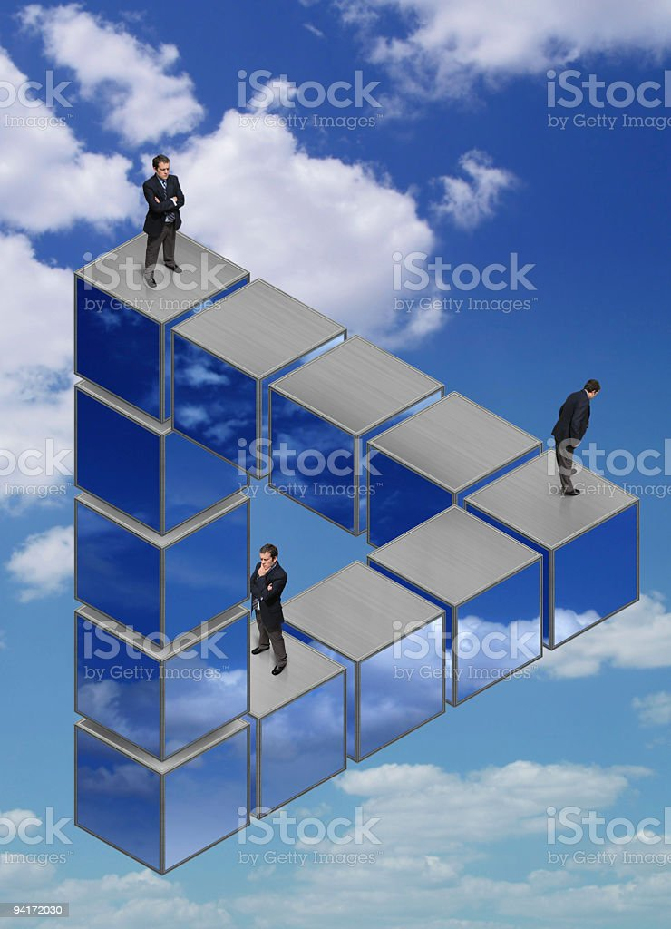 Businessmen on the Impossible Triangle royalty-free stock photo