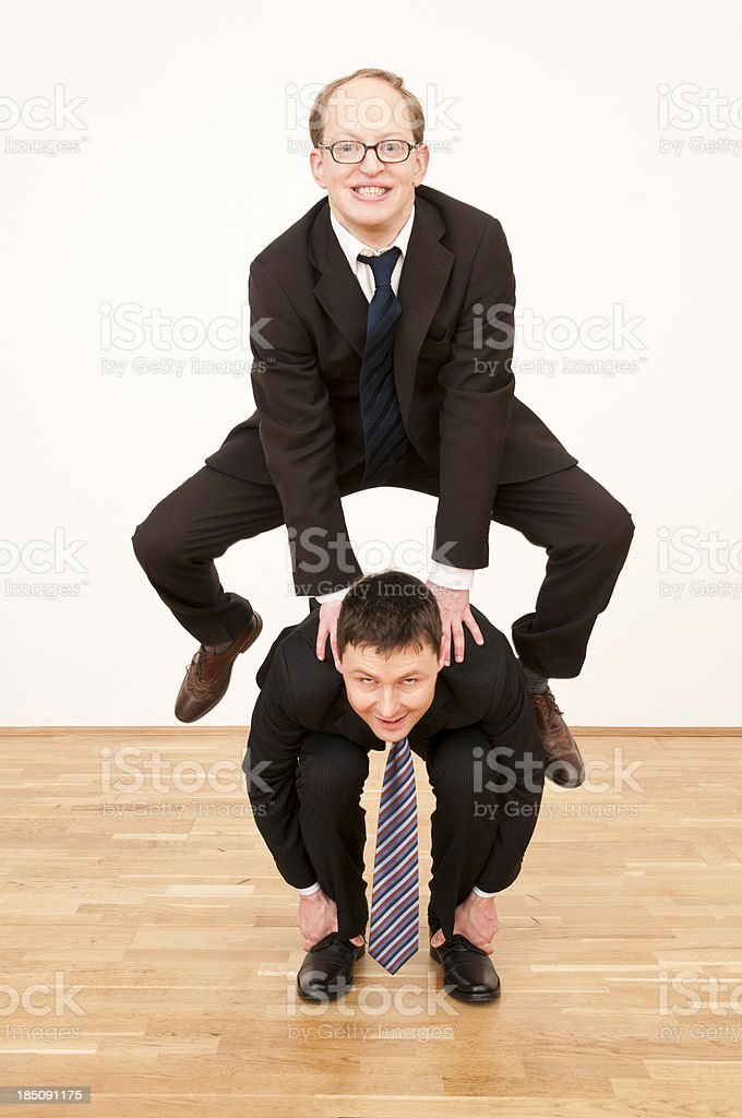 businessmen playing leapfrog stock photo
