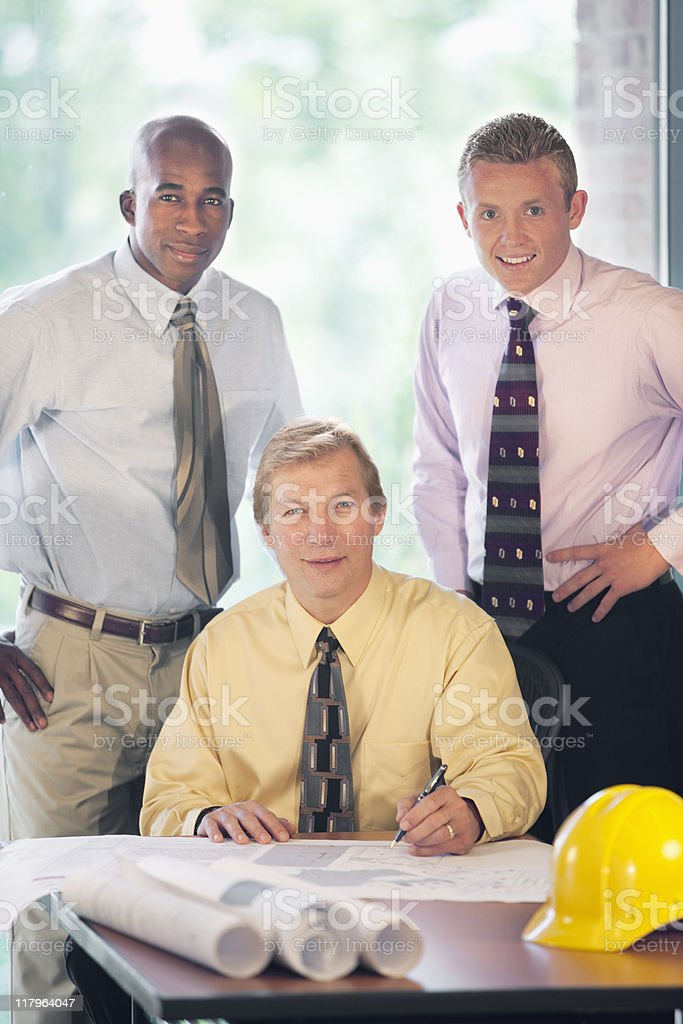 Businessmen Posing In The Office royalty-free stock photo