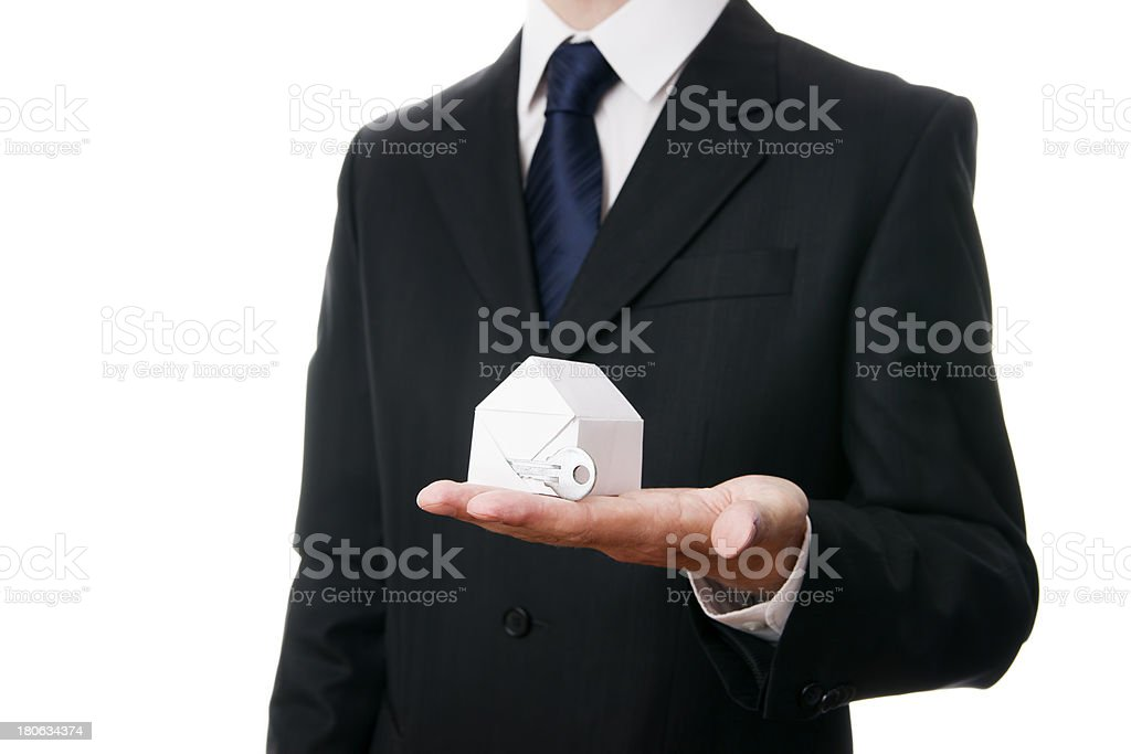 Businessmen presenting model house royalty-free stock photo