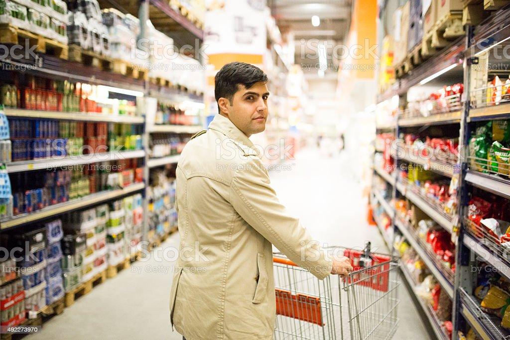 Businessmen pushing shopping cart stock photo