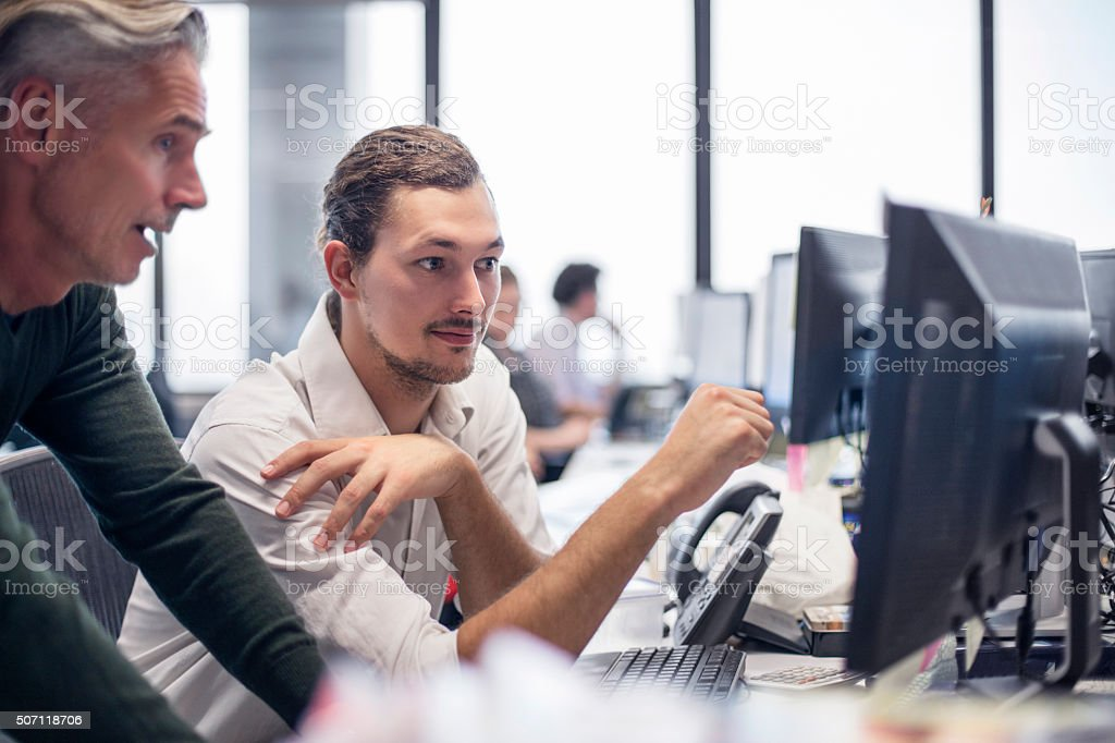Businessmen reviewing some financial work stock photo