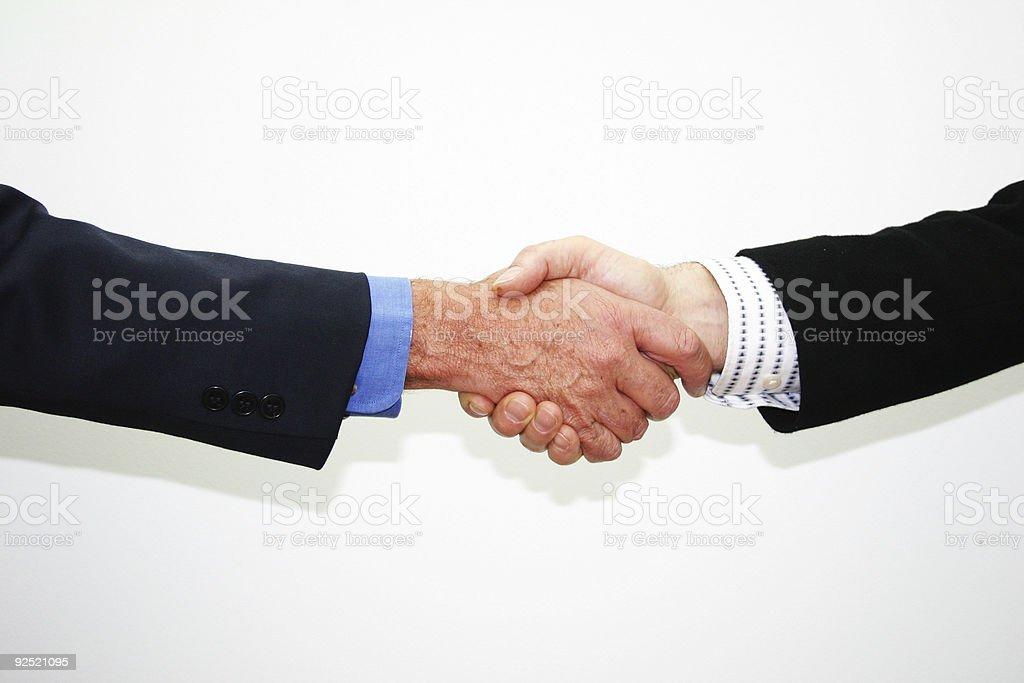 Businessmen shake hand stock photo