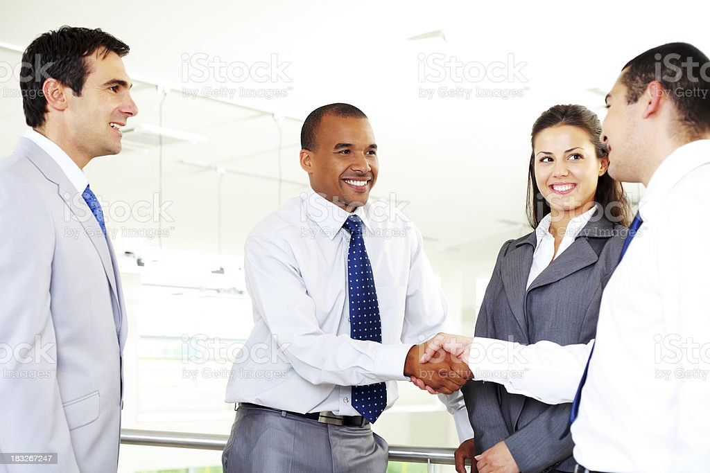 Businessmen shaking hands in the business building. royalty-free stock photo