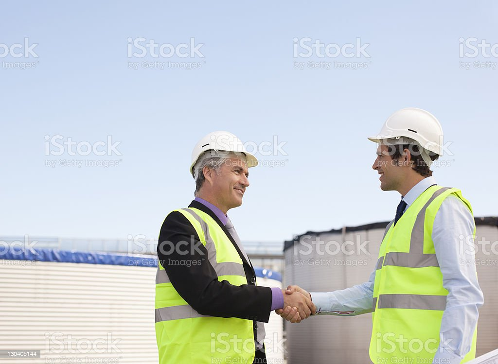 Businessmen shaking hands outdoors royalty-free stock photo