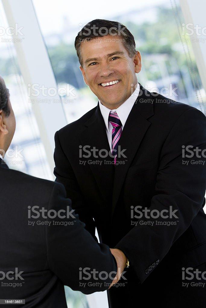 Businessmen shaking hands stock photo