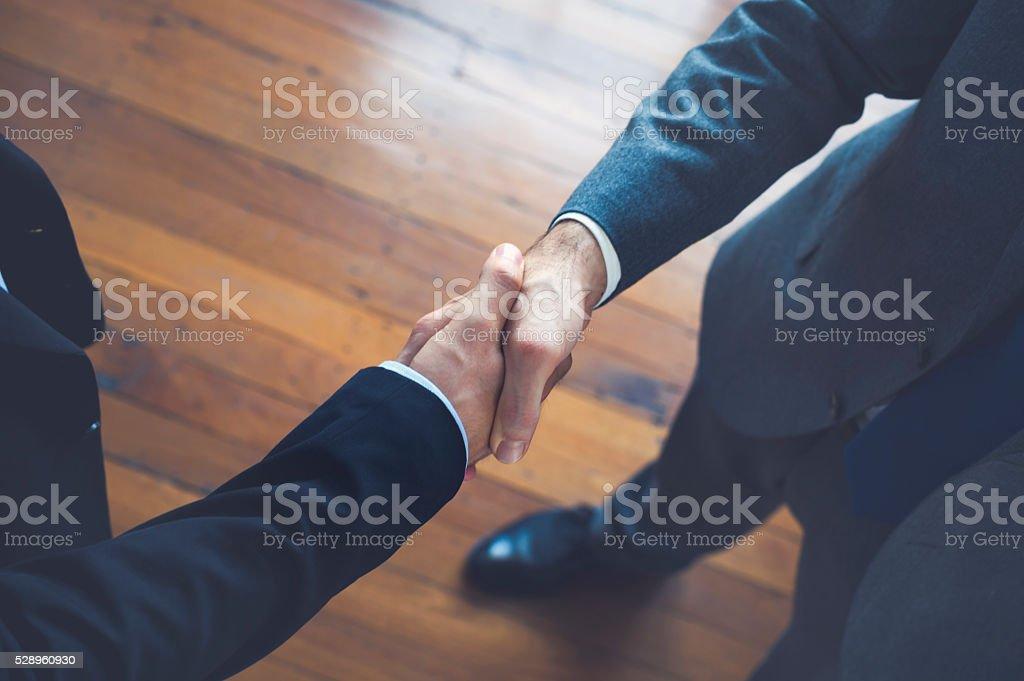 Businessmen shaking hands. stock photo
