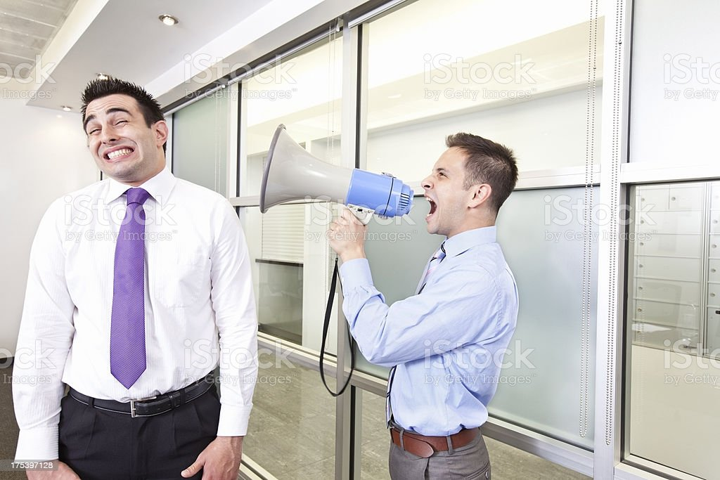Businessmen shouts with a Megaphone stock photo