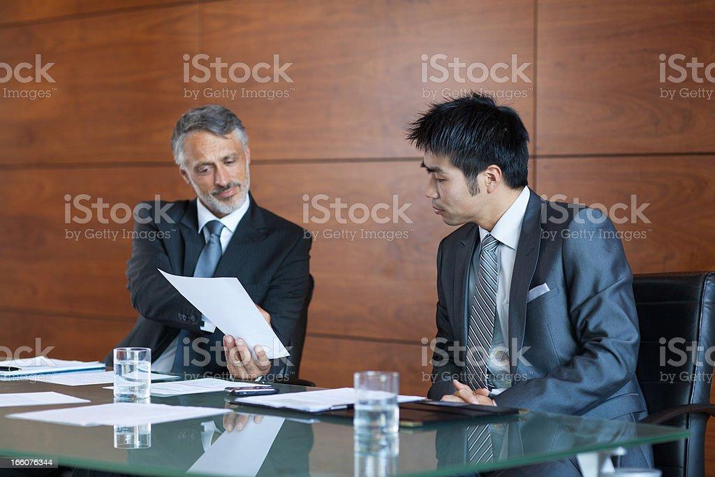 Businessmen signing paperwork royalty-free stock photo