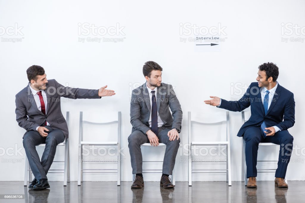 businessmen sitting in queue and waiting for interview in office, business concept stock photo