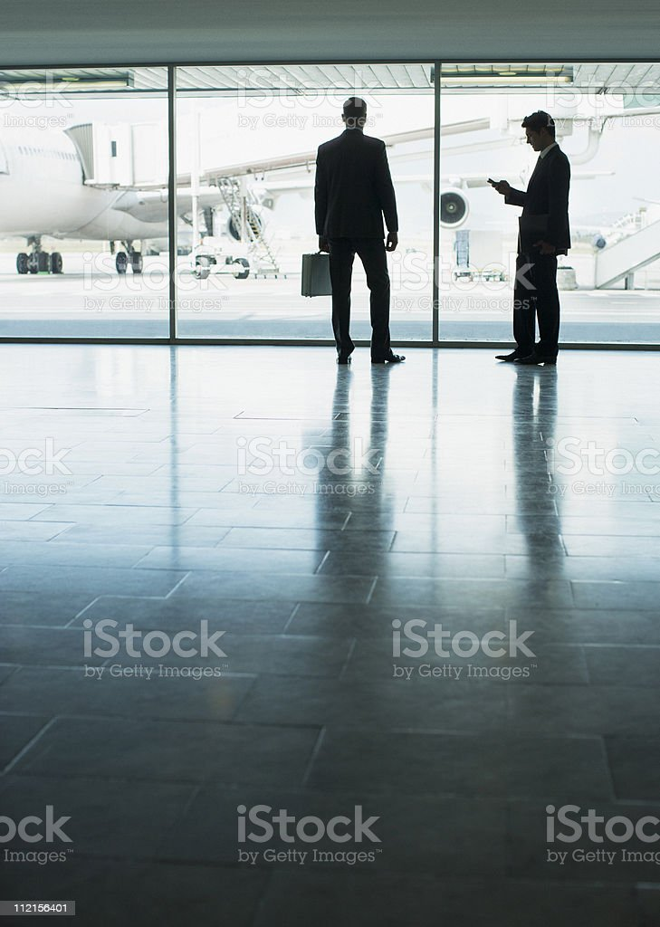 Businessmen standing in airport royalty-free stock photo