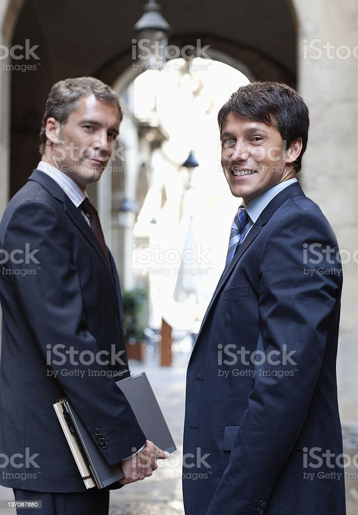 Businessmen standing together outdoors royalty-free stock photo