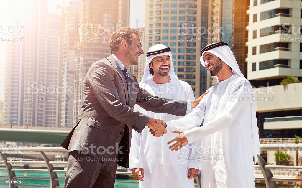 Businessmen struck a deal in Dubai. stock photo