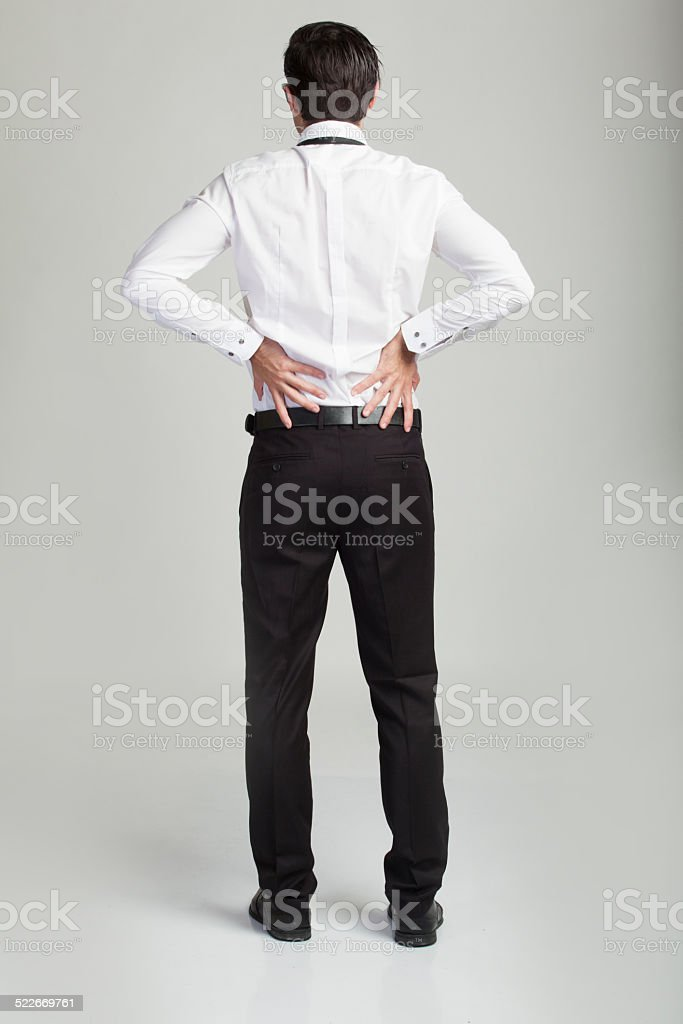 businessmen suffering from back pain stock photo