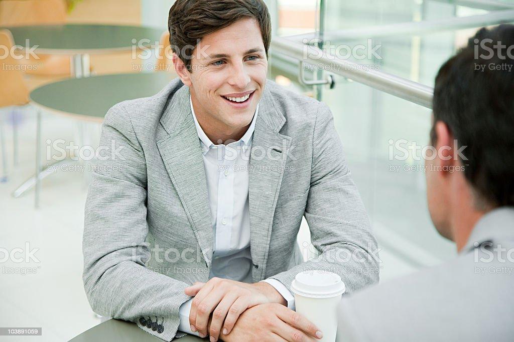 Businessmen taking a coffee break stock photo