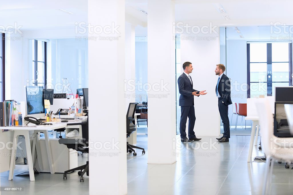 Businessmen talk at the office stock photo