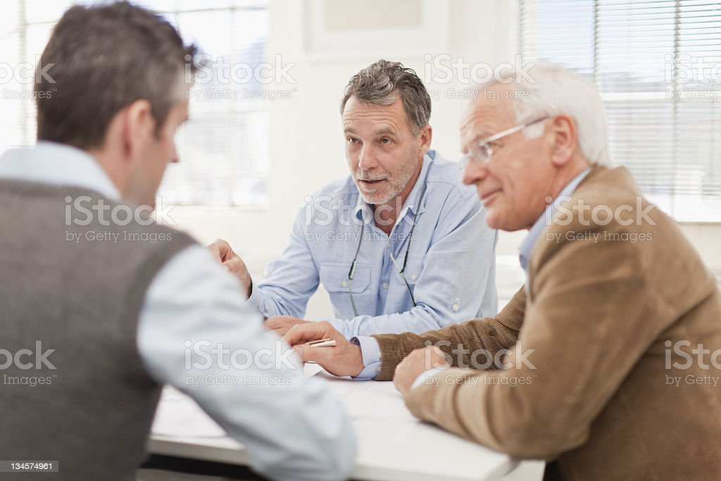 Businessmen talking in meeting stock photo