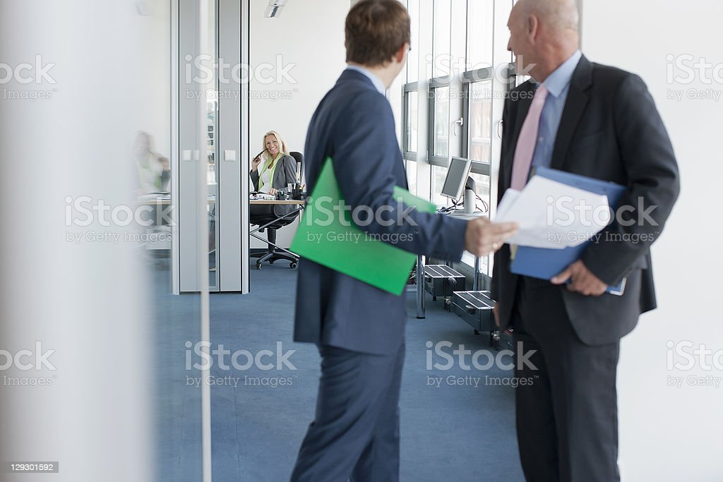 Businessmen talking in office royalty-free stock photo