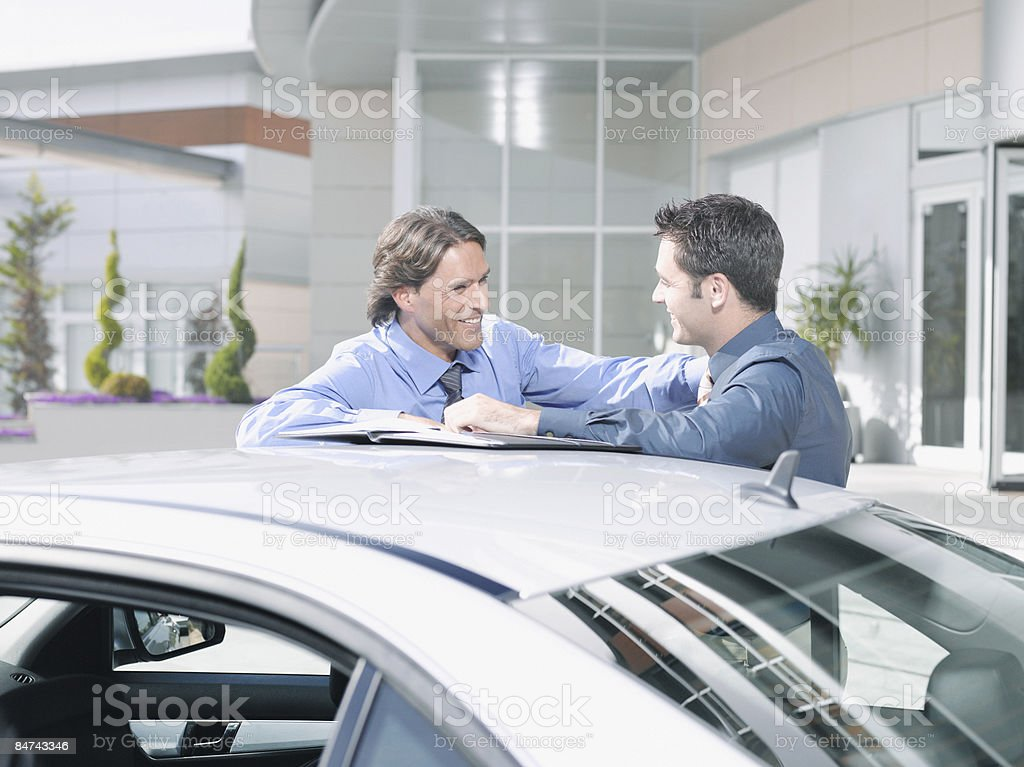 Businessmen talking near car royalty-free stock photo