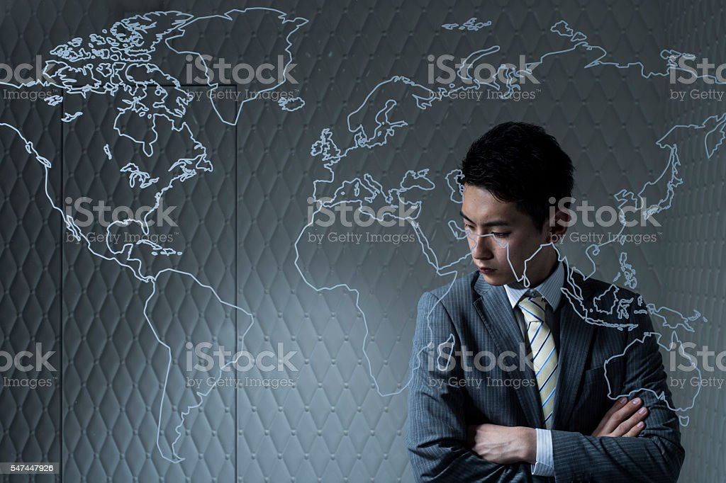 Businessmen thinking in order to make company for global expansion stock photo