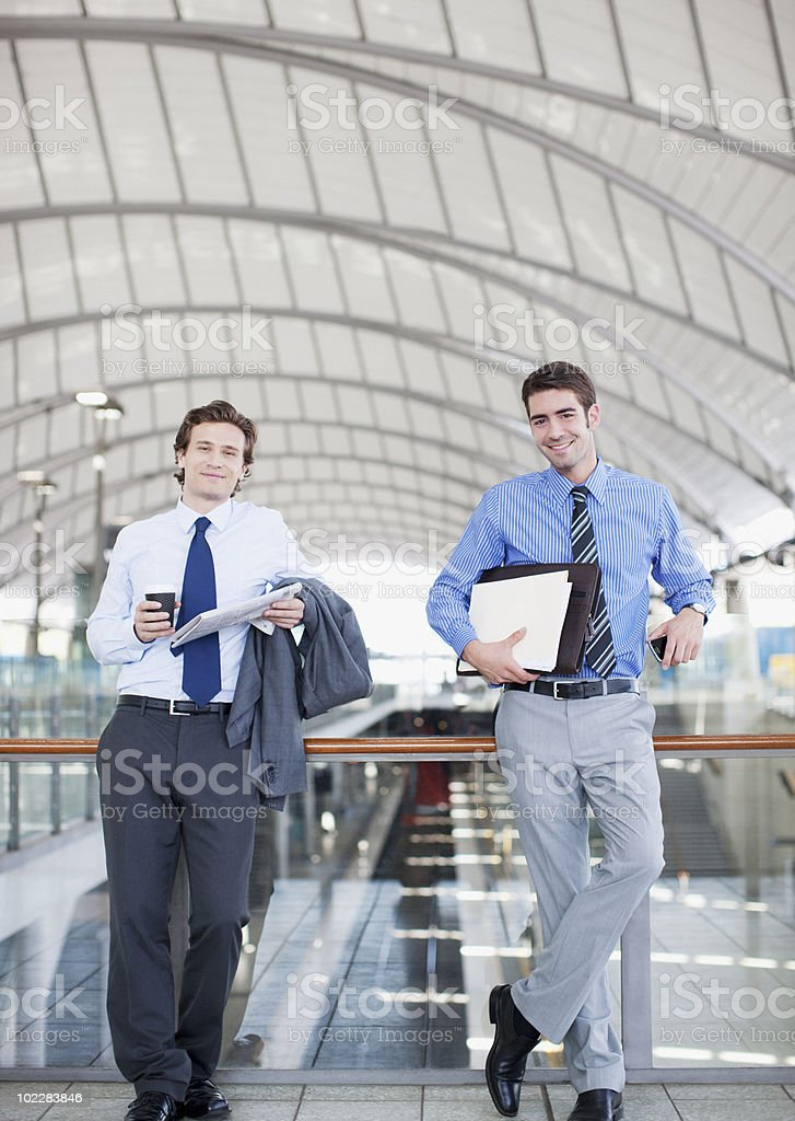 Businessmen waiting in train station royalty-free stock photo