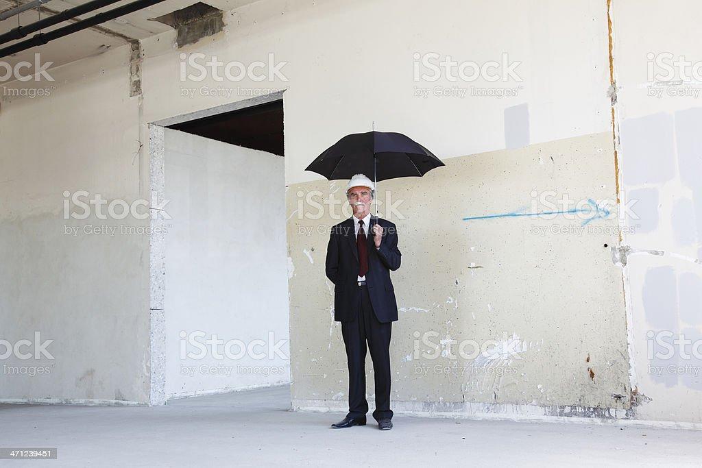Businessmen waiting with opened umbrela royalty-free stock photo