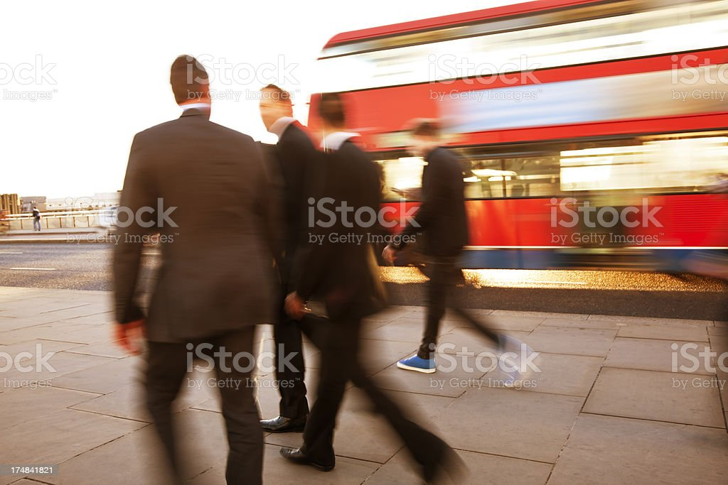 Businessmen Walking Down Street, Double Decker Bus Passing By, London royalty-free stock photo