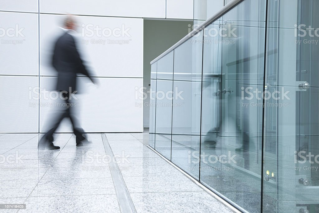 Businessmen walking in a modern interior royalty-free stock photo
