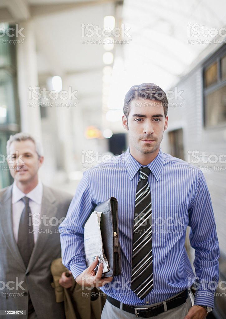 Businessmen walking on train platform royalty-free stock photo