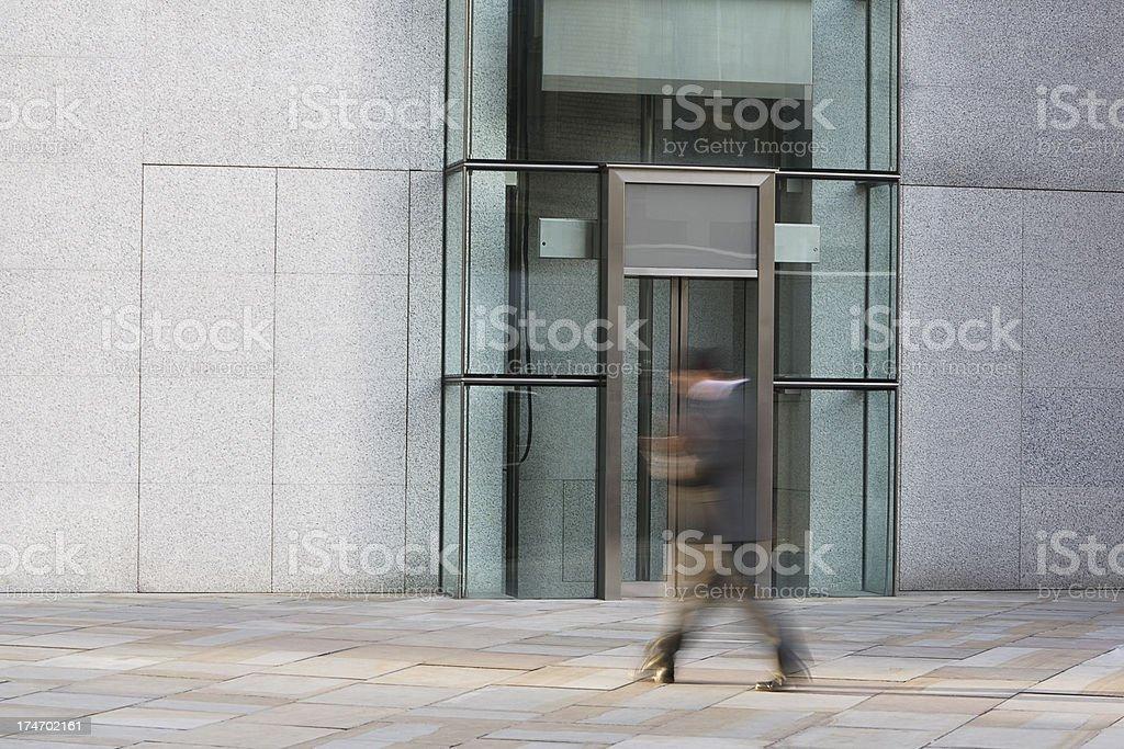 Businessmen Walking Past Elevator royalty-free stock photo
