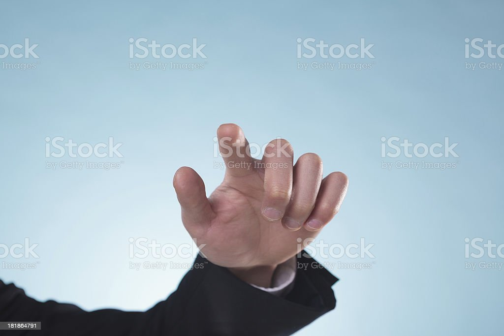 businessmen  white background is touching on glass. Focused at royalty-free stock photo