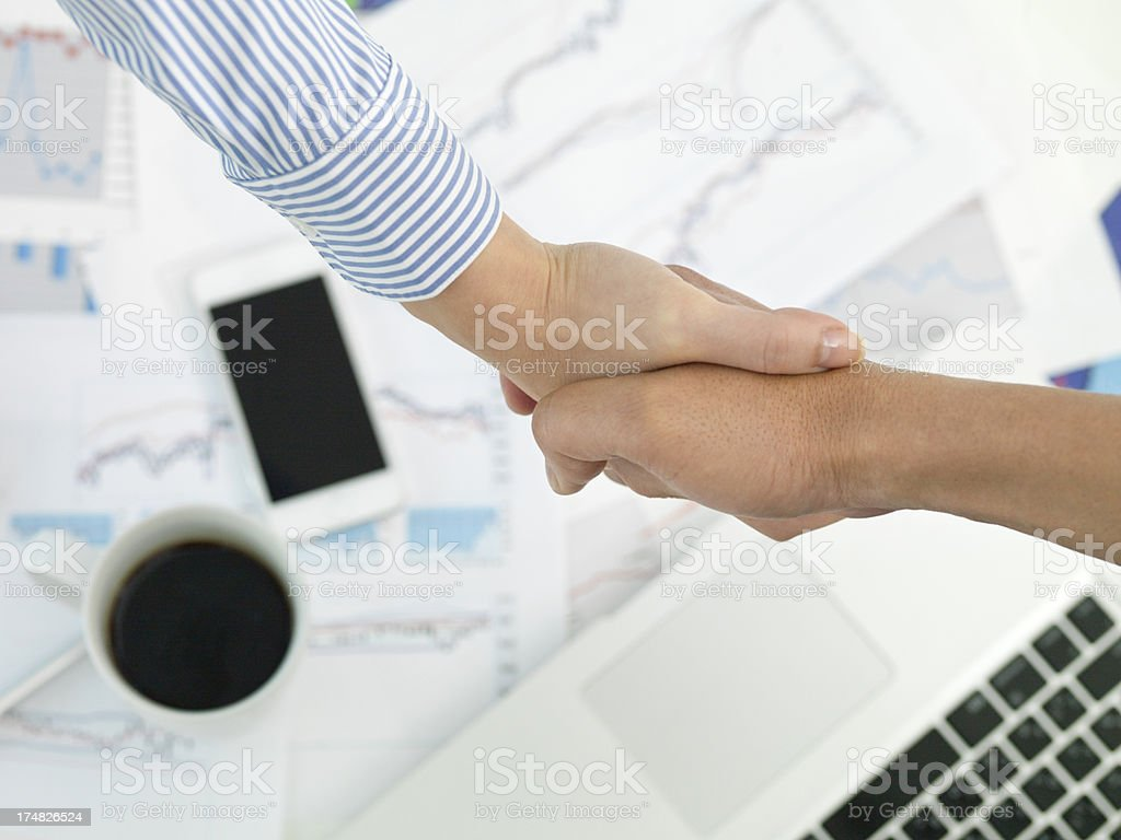 Businessmen who shake hands in a conference room royalty-free stock photo